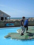 Two people walking on the Ventnor paddling pool