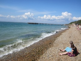 Ladies sitting on stony beach at Totland Bay