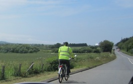 Cyclist in hi-vis jacket on the Isle of Wight