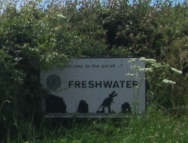 Freshwater sign with a dinosaur
