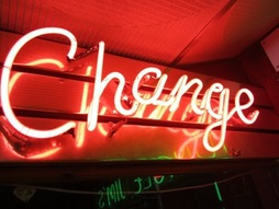 Neon change sign at an amusement arcade