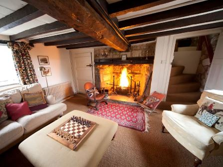 Open fire at Afton thatch cottage