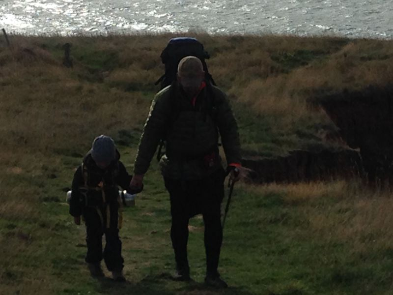 Two walkers on the cliffs near Compton Bay