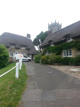 Church at thatched houses in Godshill
