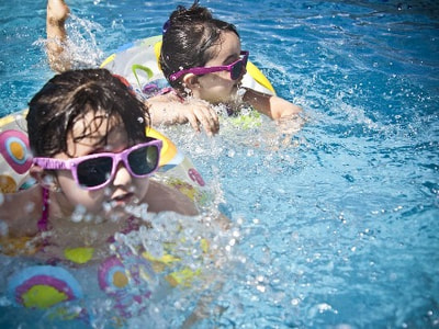 Children swimming at a holiday park